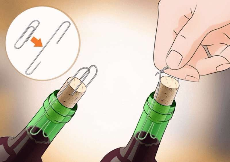Подцепить пробку двумя скрепками